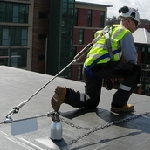 Worker using fall protection equipment